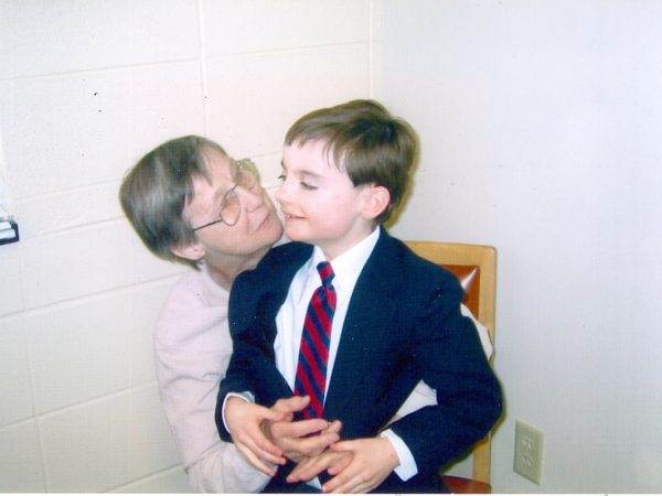 Sister Mary Agnes holding young boy on her lap.